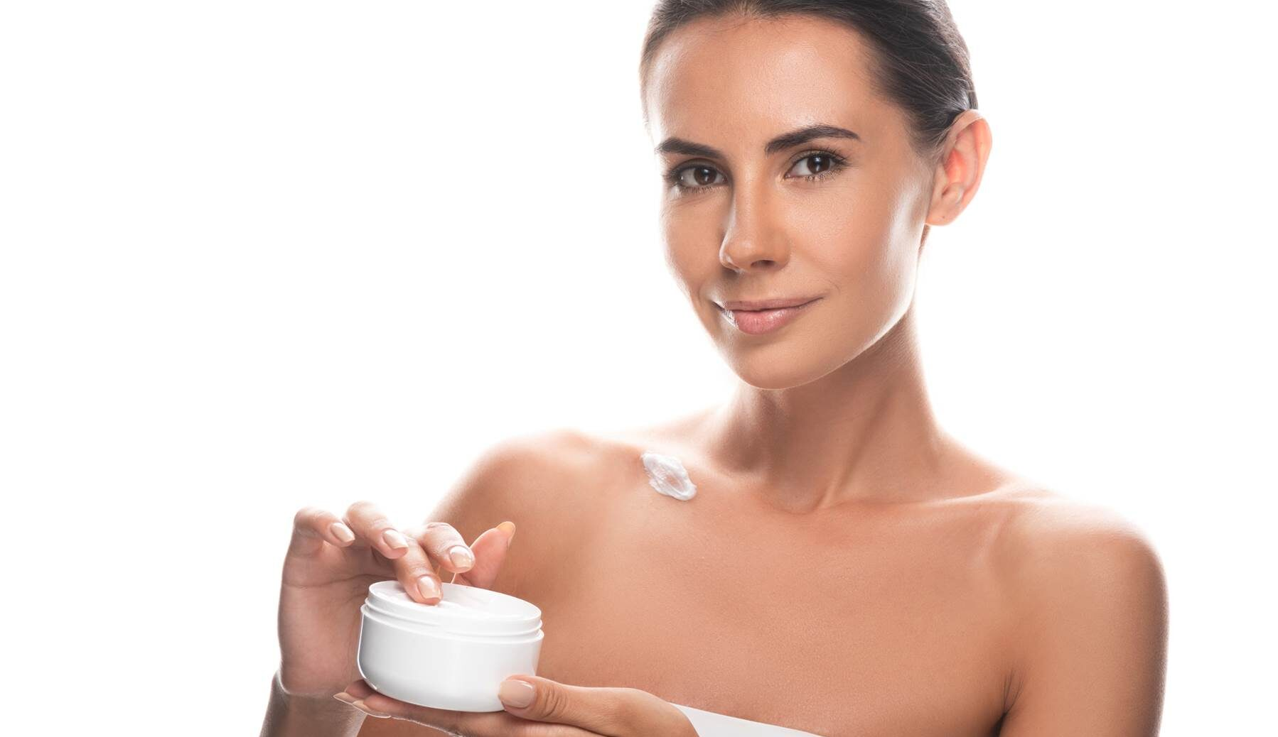 Beautiful woman using quality skincare products